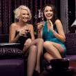 Amazing young girls smiling and drinking - Stok fotoraf