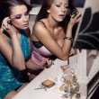 Two beautiful girls doing make up - Stok fotoraf
