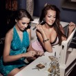Beautiful friends doing make up and preparing for the party - 