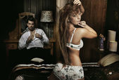 Amazing sexy couple having fun in romantic room — Stok fotoğraf