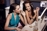 Two smiling women doing make up — Stock Photo