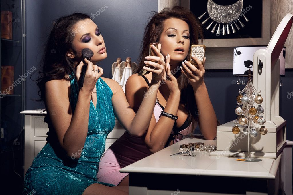 Two young beauty doing make up and preparing for the party  Stock Photo #4749814