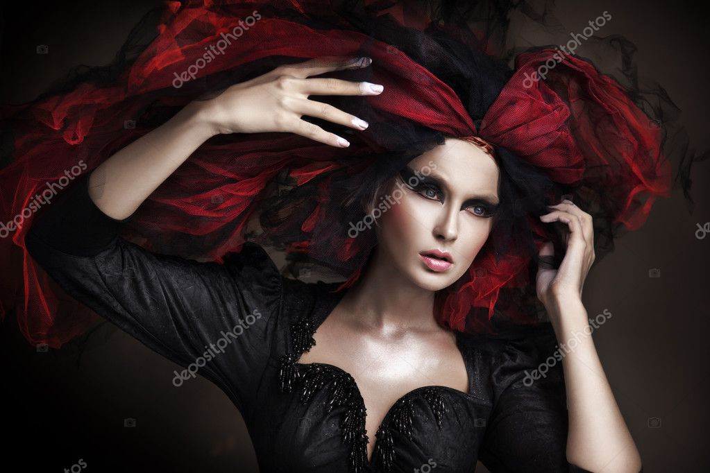 Portrait of beautiful girl with dark make up and amazing style   #4750518