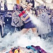 Nice girl irl is extinguishing the fire of clothes — Stok fotoğraf
