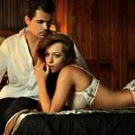 Sexy couple in bedroom — Stock Photo