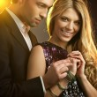 Happy young man gifting a ring to a beautiful young woman - Stockfoto