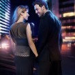 Amazing couple in love over the city background — Stock Photo
