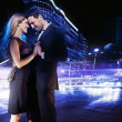 Handsome young couple dancing on street and smiling — Stock Photo #4897327