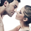 Portrait of handsome couple gently kissing — Stock Photo