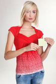 Portrair of blonde pretty girl holding an empty paper — Stock Photo
