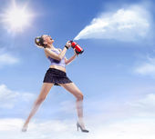 Young beautiful woman with fire extinguisher — Stock Photo