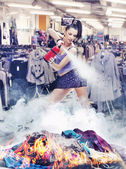 Nice girl irl is extinguishing the fire of clothes — Stock Photo