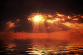 Hot sunset over water surface — Stock Photo
