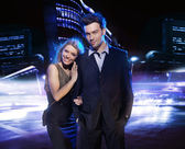 Young couple over the night city background — Foto Stock