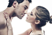 Portrait of handsome couple gently kissing — Stockfoto