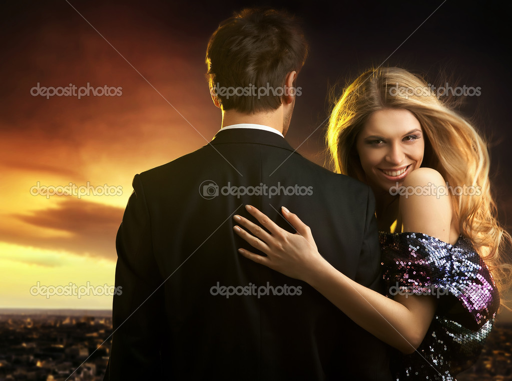 Conceptual portrait of a young couple in elegant evening dresses — Stock Photo #4897207