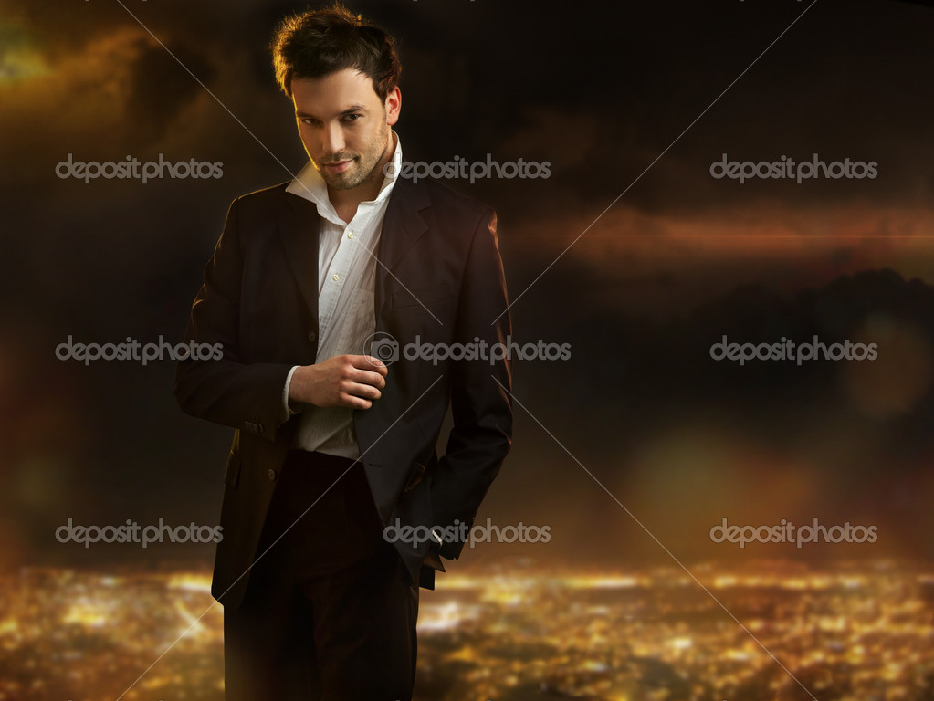 Elegant young handsome man over night city background — Stock Photo #4897236