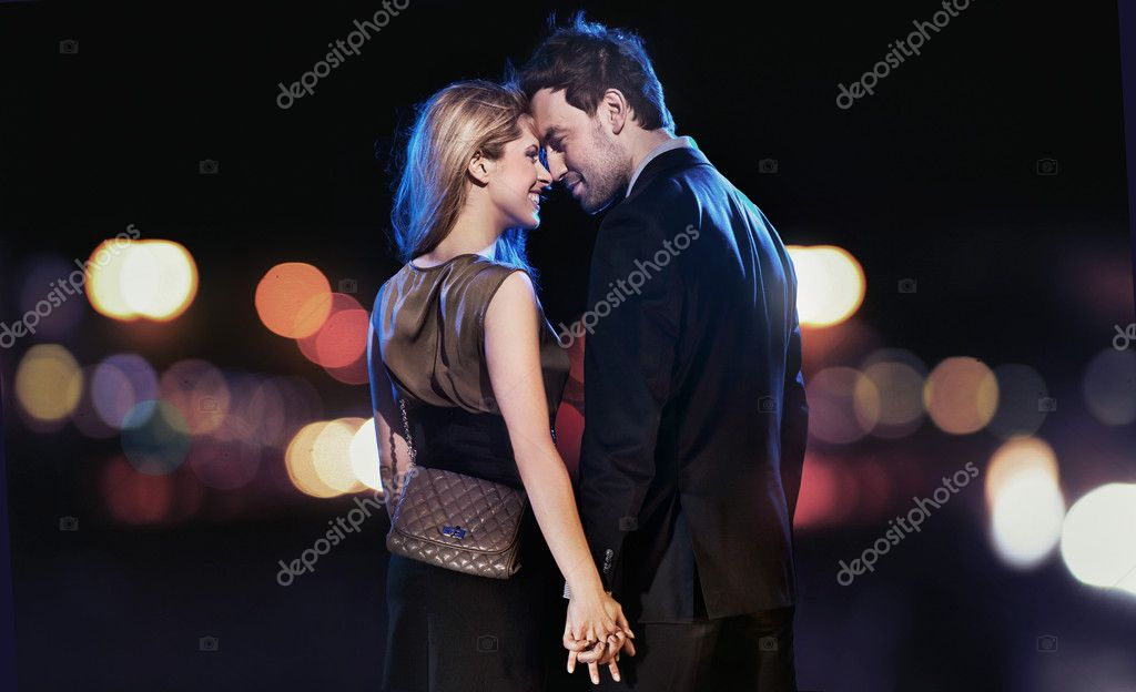 Conceptual portrait of a young couple in elegant evening dresses  Stock Photo #4897303