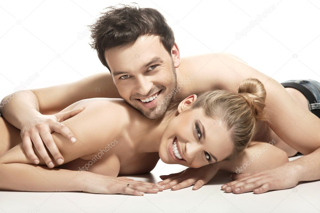 Beautiful young couple lying on the bed  Foto de Stock   #4897421