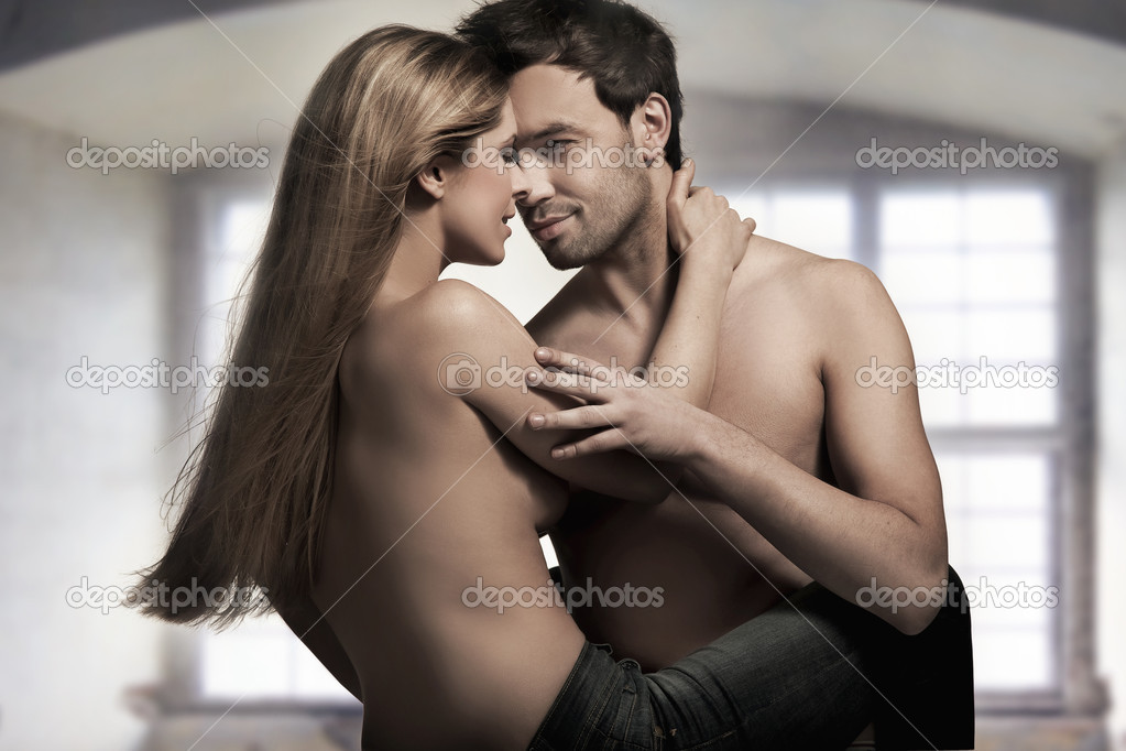Young couple in blue jeans on nice interior  Stock Photo #4897481