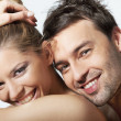 Stock Photo: Portrait of happy young woman and man smiling together