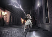 Stylish woman catching thunderbolts — Stock Photo