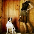 Young blonde girl with a dog on a walk - Foto de Stock  