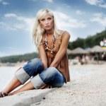 Woman relaxing on a beautiful beach — Stock Photo #4967425