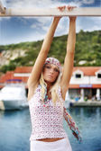 Hippie looking young blonde on a sunny day — Stock Photo