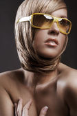 Portrait of pretty woman in sunglasses — Stock Photo