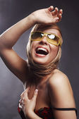 A beautiful young blond woman smiling in sunglasses — Stock Photo