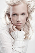 Beautiful blond woman with fashion hairstyle — Stock Photo