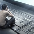 Conceptual photo of a young man addicted to the internet -  