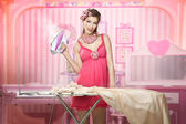 Pretty woman as a doll doing house work — Stock Photo