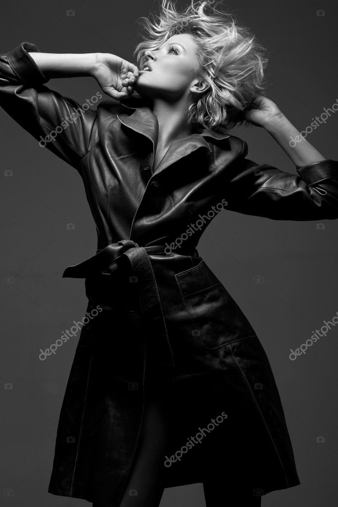 Attractive young fashion model posing in the studio — Stock Photo #5060530