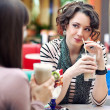 Two young women having lunch break together — Stock Photo #5087581