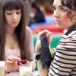 Two young women having lunch break together - Stock Photo