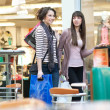 Two cute girl with shoppingbags - Stock Photo