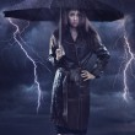 Single woman wearing coat holding umbrella. Creative szmbol of t — Stock Photo
