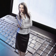 Beauty businesswoman standing on laptop — Stock Photo #5117996