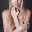 Portrait of beautiful young woman with long straight blond hair — Stock Photo