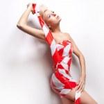 Beautiful young lady posing in amazing dress — Stock Photo