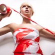 Portrait of beautiful blond woman with warning tape — Stockfoto