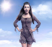 Surprised woman on the beauty sky background — Stock Photo