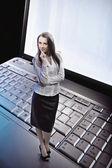 Beauty businesswoman standing on laptop — Stock Photo