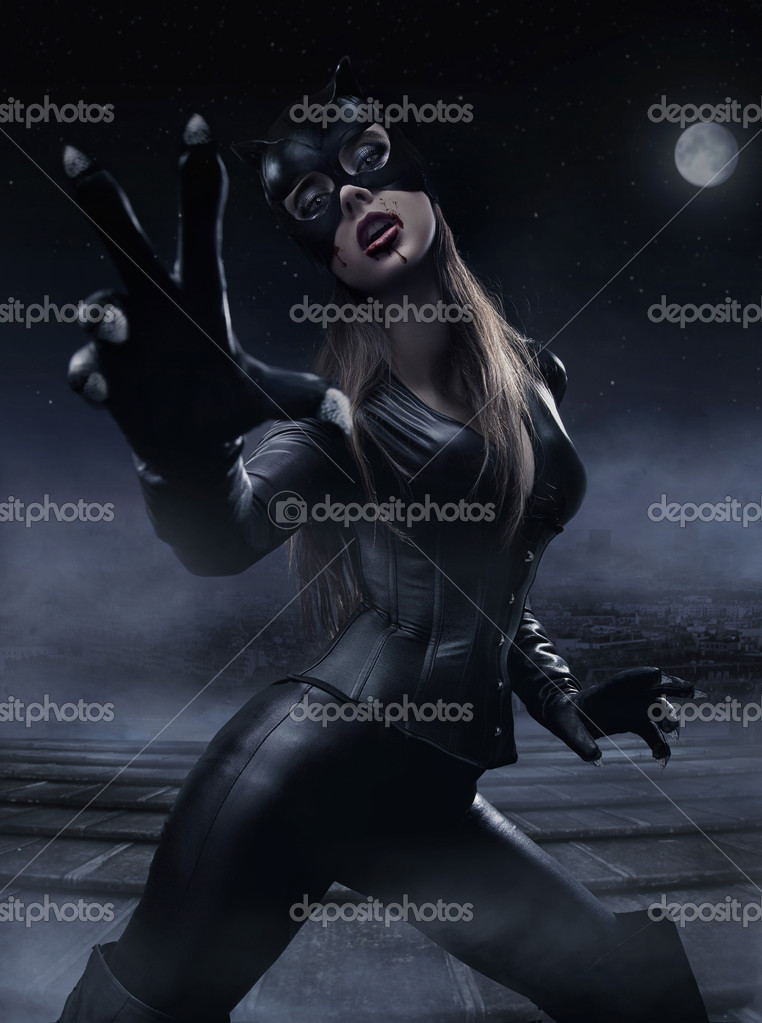 Foggy photo of a woman wearing cat's costume  Stock Photo #5115940