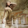 Stock Photo: Fine art photo of a young fashion lady in a stylish interior