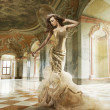 Стоковое фото: Fine art photo of young fashion lady in stylish interior