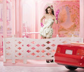 Doll like brunette in a doll house — Stock Photo