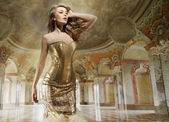 Fine art photo of a young fashion lady in a stylish interior — Stock Photo